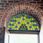 Use of recycled glass bottles above door
